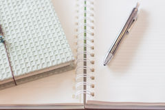Pen and greencover notebook with spiral notebook Stock Images