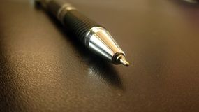 Pen With Grey Background Stockbild