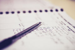Pen and guestbook with handwriting. Selective focus on pen and guestbook with handwriting royalty free stock photo