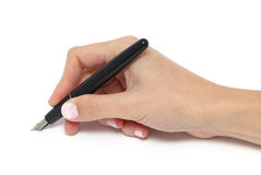 A pen in a hand. Isolated Stock Photo