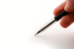 Pen in hand. Black plastic pen in fingers isolated on white Stock Photo