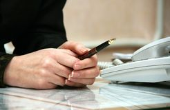Pen in hand Royalty Free Stock Photography