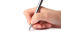 Pen in the hand. Isolated on white background Royalty Free Stock Photos
