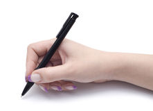 Pen in hand. Pen in female hand isolated over white Royalty Free Stock Image
