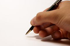 The pen in the hand. Hand with the pen on the whote background stock photography