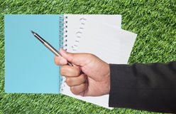 Pen in hand of business Royalty Free Stock Image