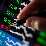 Pen in hand financial chart Royalty Free Stock Photo