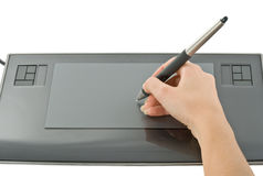 Pen in hand on graphic tablet Stock Photography