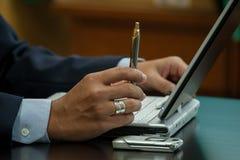 Pen hand laptop Stock Photo