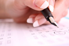 Pen in hand make some corrections. In printed digits Royalty Free Stock Photo