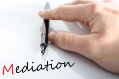 Pen in the hand mediation concept. Pen in the hand  over white background mediation concept Stock Photo