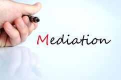 Pen in the hand mediation concept. Pen in the hand  over white background mediation concept Stock Image