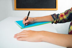A pen in hand of schoolboy Stock Photos