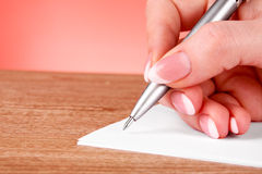 Pen in hand writing Royalty Free Stock Photography