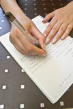 Pen in hand writing Stock Photography