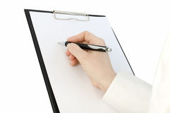 Pen in hand writing on the page Royalty Free Stock Images