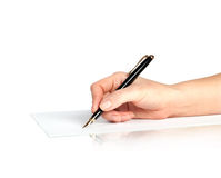 Pen in hand writing on the page Royalty Free Stock Image