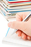 Pen in hand writing post cards. Royalty Free Stock Images