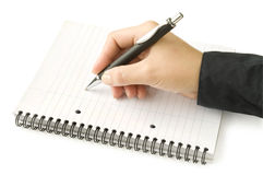 Pen in hand writing on the white page Stock Photos