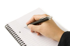 Pen in hand writing on the white page Stock Photo