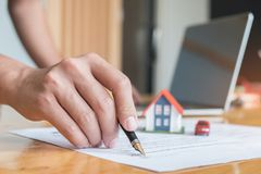 Pen handles signed documents with model houses, model car and la stock photography