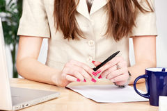 Pen in a hands of a business woman Royalty Free Stock Photography