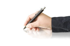 Pen in hands writing Stock Photo