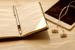 Pen and headphones Royalty Free Stock Images