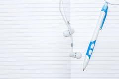 Pen and headphones Royalty Free Stock Photos