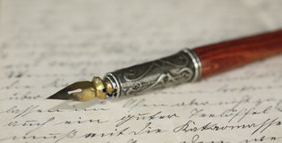 Pen holder and letter. Close-up of a pen holder on an old letter Royalty Free Stock Image