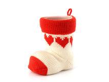 Pen holder made of knitted yarn sock with red heart pattern and axis is a plastic cup isolated on white background. Pen holder made of knitted yarn sock with red Royalty Free Stock Photos