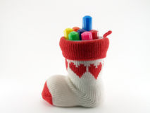 Pen holder made of knitted yarn sock with red heart pattern and axis is a plastic cup with colorful color pen (felt tip. Pen holder made of knitted yarn Stock Image