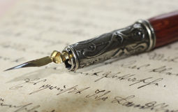 Pen holder on an old letter. Close-up of a pen holder on an old letter, written by my grandmother Stock Photo