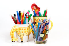 Pen holders with colored pens Royalty Free Stock Photography