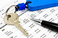 Pen, House key and Interest rates on bank loans Royalty Free Stock Photo