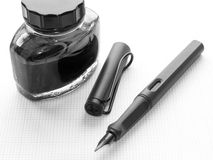 Pen and ink. Pen and ink with ink bottle Stock Image