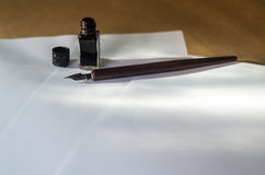 Pen and ink white sheets on a work table Royalty Free Stock Images