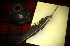 Pen with inkpot standing on the table royalty free stock photography