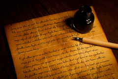 Pen and inkwell on antique  paper Royalty Free Stock Image
