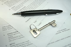 Pen and key on a legal contract Royalty Free Stock Image