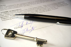 Pen and key on a legal contract Royalty Free Stock Photo