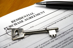Pen and key on property purchase agreement Stock Photos