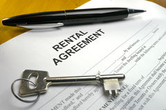 Pen and key on rental agreement Royalty Free Stock Photography