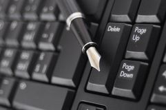 Pen and keyboard Royalty Free Stock Image
