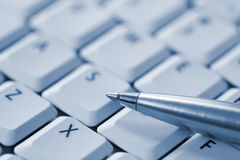 Pen on Keyboard Stock Photo