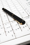 Pen on keyboard Royalty Free Stock Photos