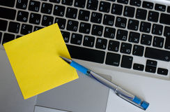 Pen on the keyboard Stock Photography
