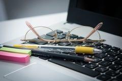 Pen on keyboard Stock Image
