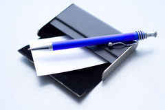 Pen laying on a case for cards Royalty Free Stock Images