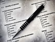 Pen laying on a customer satisfaction form Royalty Free Stock Images